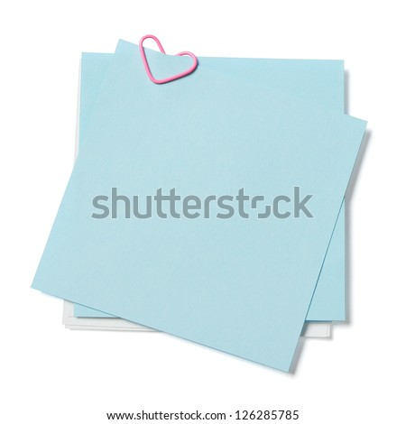 blue and white sticky notes with paper clip in shape of heart on white background - stock photo