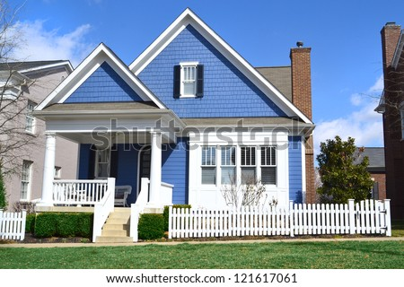Blue and White Suburban American Cape Cod Home with Front Porch
