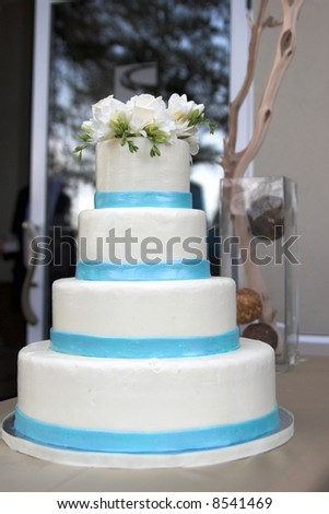blue and white tiered wedding cake - stock photo