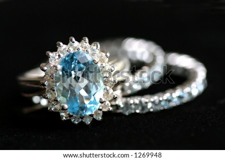 Blue and white topaz ring in silver - stock photo