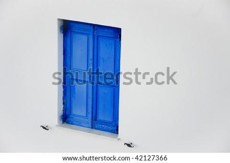 Blue and white window in Mykonos greece - stock photo