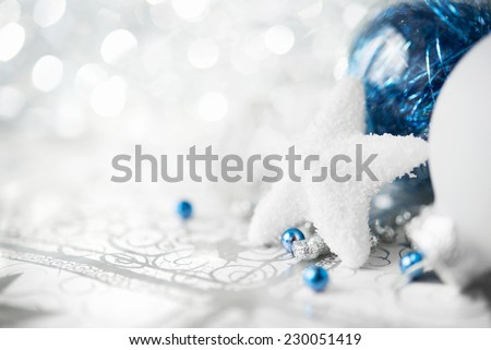 Blue and white xmas ornaments on bright holiday background with space for text. Merry christmas card. Winter holidays. Xmas theme. - stock photo