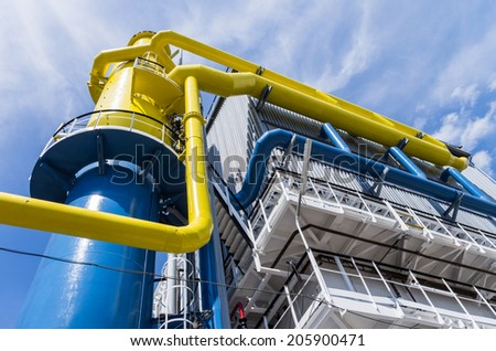blue and yellow big pipelines on blue sky - stock photo