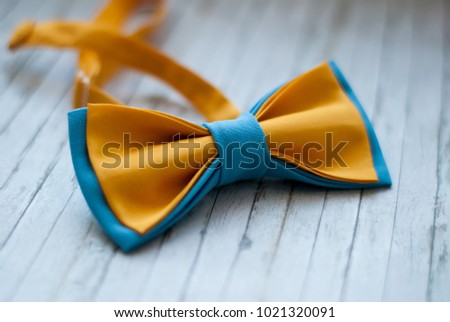 Blue Yellow Bowtie On Wooden Background Stock Photo Royalty Free