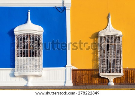 Blue and yellow colonial architecture in the historic center of Trujillo, Peru - stock photo
