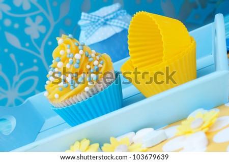 Blue and yellow cupcake setting - stock photo
