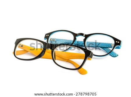Blue and Yellow eye glasses isolated over the white background . - stock photo