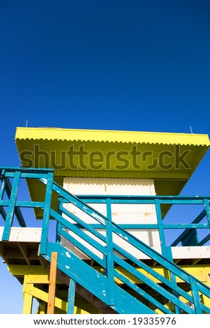 Blue and Yellow Generic Lifeguard Station or Hut - stock photo