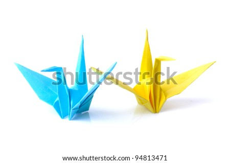 Blue and yellow origami bird isolated on white background - stock photo