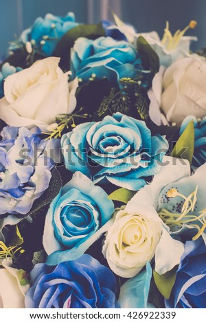 Blue and yellow roses flower wedding backdrop bouquet background. Vintage filter - stock photo