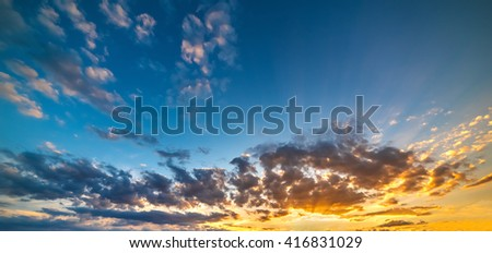 blue and yellow sky at sunset - stock photo