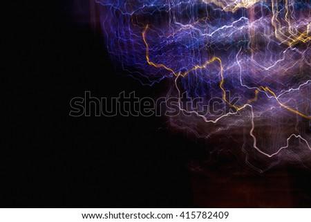 Blue and yellow streaks of light in the dark background, digital illustration art work. - stock photo
