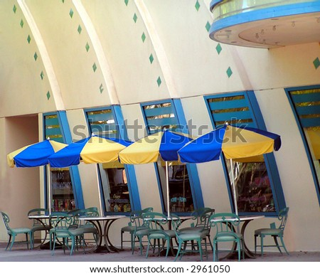 blue and yellow umbrellas at an outdoor cafe - stock photo