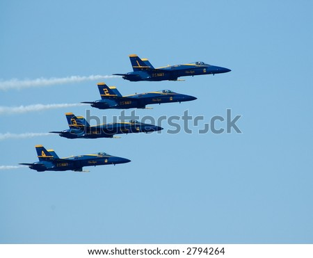Blue Angels' F18 jets 1 through 4 in a very tight formation at a Fleet Week 2006, San Francisco, CA.