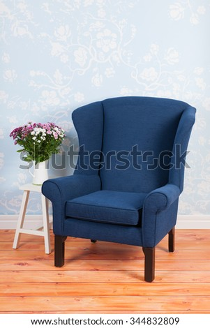 Blue arm chair in vintage interior - stock photo