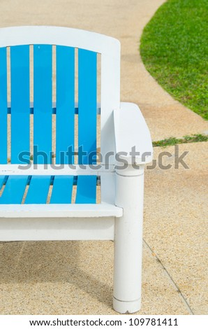 Blue armchair on Green Grass at the Beach