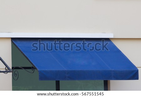 Blue Awning Over Glass Window