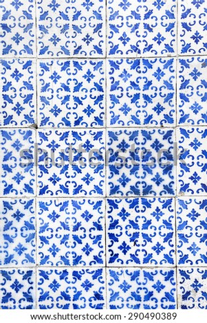Blue azulejos on the building's exterior in Lisbon, Portugal. It is a form of Spanish and Portuguese painted tin-glazed ceramic tilework. - stock photo