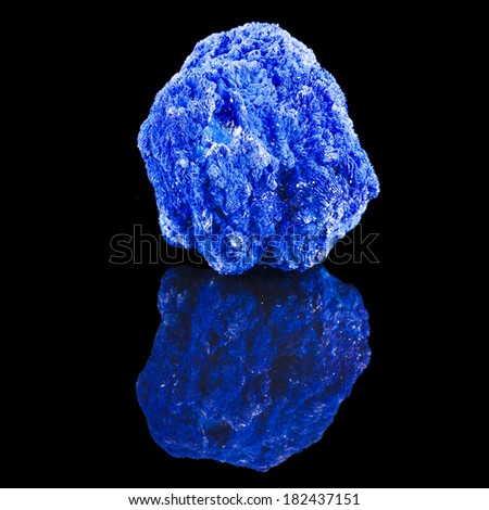 Blue Azurite mineral stone, with reflection on black surface background  - stock photo