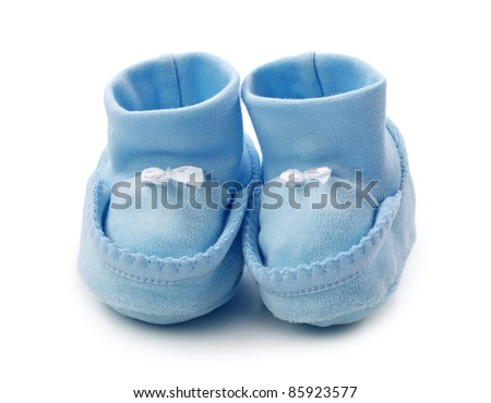 Blue baby booties on white background