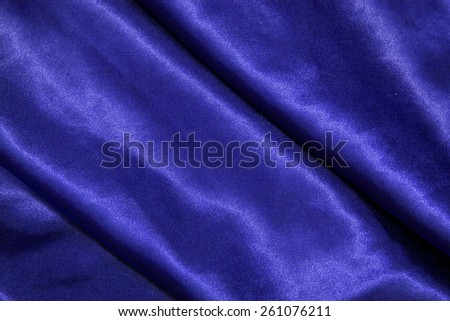 blue background abstract cloth of wavy folds of silk texture satin or velvet material or design of elegant curves blue material - stock photo