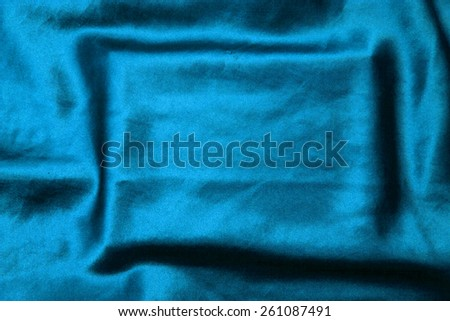 blue background abstract cloth of wavy folds of silk texture satin or velvet material or  wallpaper design of elegant curves blue material - stock photo