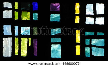 Blue background: closeup of abstract design in a piece of chipped slab glass in a stained glass window - stock photo