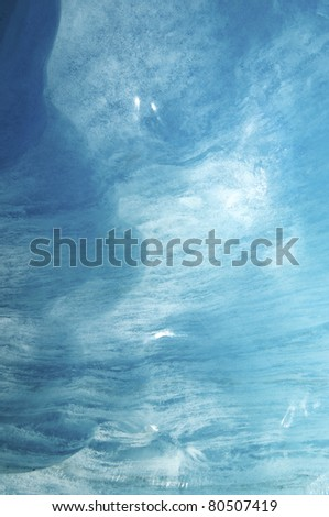 blue background created by the ice cave on the Mer de Glace glacier,  Chamonix, France - stock photo