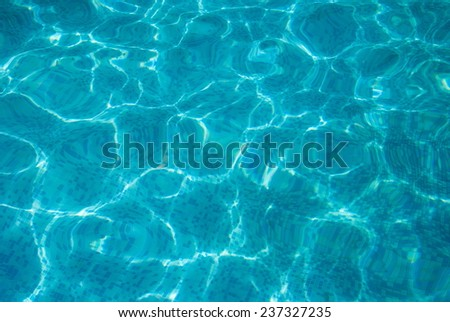 Blue background from mosaic and crystal clear water - stock photo
