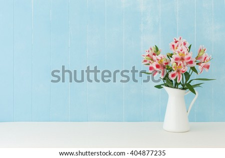 Blue background of Alstroemeria  flowers - stock photo