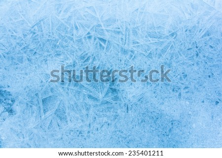 Blue background of cold frosty ice. - stock photo