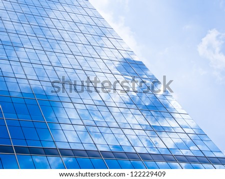 blue background of glass high rise building skyscrapers in modern futuristic downtown at  Business concept of successful industrial architecture - stock photo