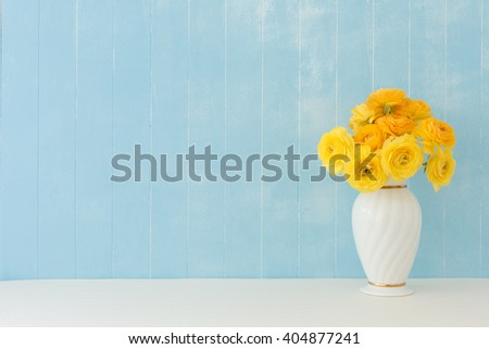 Blue background of Ranunculus flowers - stock photo