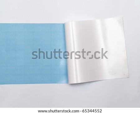 blue background visible through the white paper wrapped