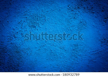Blue background wall texture with dark edges