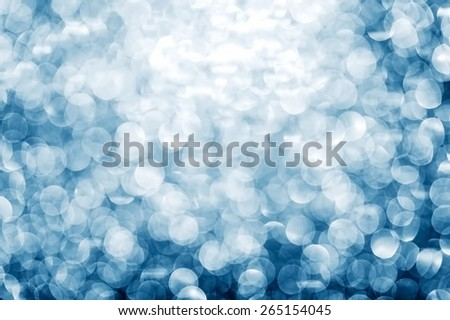 Blue background with shimmering glitter - Defocused lights. - stock photo