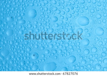 Blue background with water drop. Rain drop on the glass