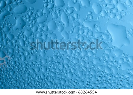 Blue background with water drop. Rain drop on the glass - stock photo