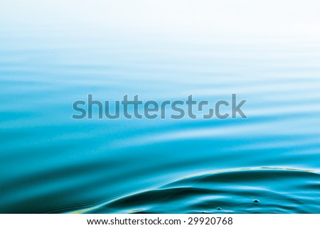 Blue background with water ripples - stock photo