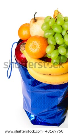 Blue bag with fruits on white background - stock photo