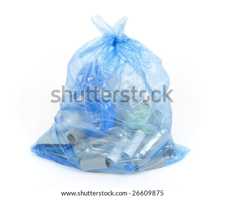 Blue bag with plastic and cardboard for recycling. - stock photo