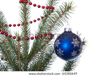 blue ball hangs on christmas tree with red garland isolated on white