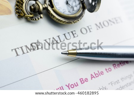 Blue ballpoint pen on a sheet of time value of money which explains why interest is paid or earned : interest, whether it is on a bank deposit or debt, compensates depositor or lender for the TVM.