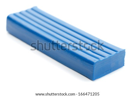 Blue bar of plasticine isolated on white