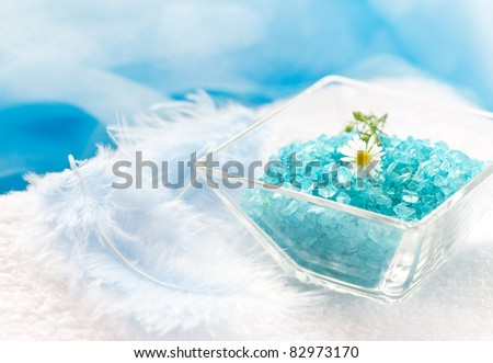 blue bath salt in bowl with blossom - stock photo