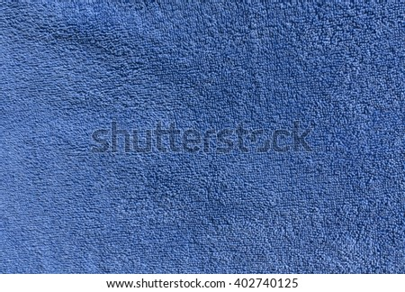 Blue bath towel texture. Background and texture for design. - stock photo