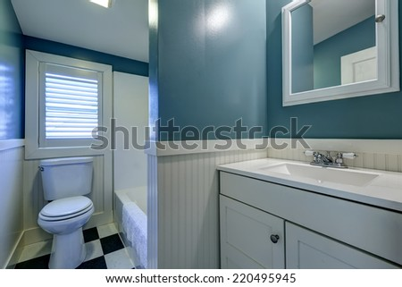 Blue bathroom interior with white wall trim - stock photo