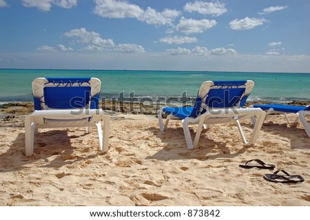 Blue Beach Chairs in the Sand - stock photo