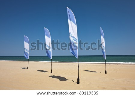 Blue beach flags - stock photo