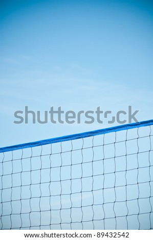 Blue beach volleyball net against blue sky. Copy space for your text. - stock photo